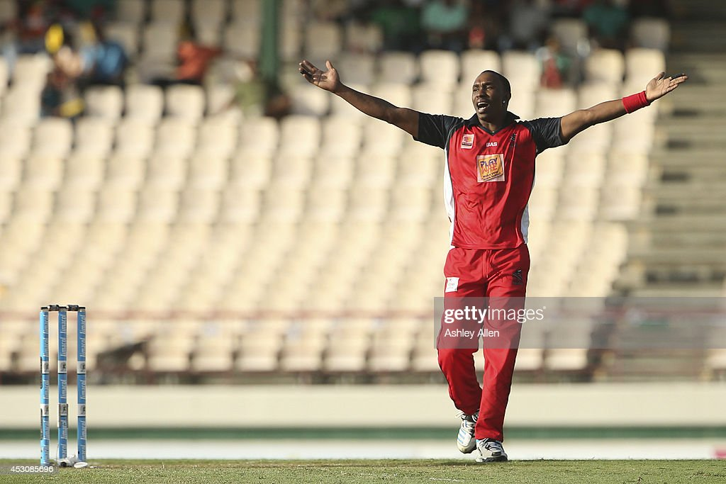 Captain of The Red Steel <a gi-track='captionPersonalityLinkClicked' href=/galleries/search?phrase=Dwayne+Bravo&family=editorial&specificpeople=178945 ng-click='$event.stopPropagation()'>Dwayne Bravo</a> celebrates a wicket during a match between St. Lucia Zouks and The Trinidad and Tobago Red Steel as part of week 4 of the Limacol Caribbean Premier League 2014 at Beausejour Stadium on August 02, 2014 in Castries, St. Lucia.