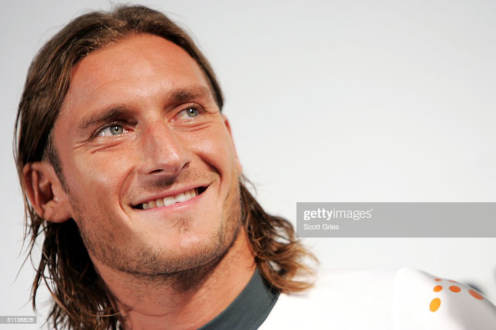 Captain of the Roma soccer team, <a gi-track='captionPersonalityLinkClicked' href=/galleries/search?phrase=Francesco+Totti&family=editorial&specificpeople=208985 ng-click='$event.stopPropagation()'>Francesco Totti</a>, appears on stage during a party to celebrate the Diadora & A.S. Roma launch of 'Champions League Shirt' at the Guggenheim Museum August 2, 2004 in New York City.