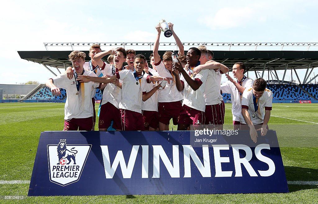 Captain of Thomas Telford School, Alex Mitchell lifts the trophy after victory during the under 16 Schools' Cup final match between Thomas Telford School and Samuel Whitbread Academy at the Academy Training Ground on May 04, 2016 in Manchester, England.