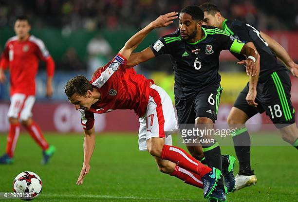 Captain of Wales Ashley Williams vies with Austria's Florian Klein during the WC 2018 football qualification match between Austria and Wales in...