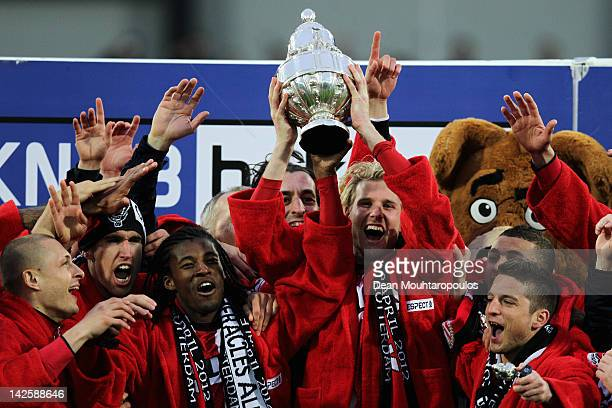 Captain Ola Toivonen of PSV leads celebrations with the trophy after victory in the Dutch Cup Final between PSV Eindhoven and SC Heracles Almelo at...