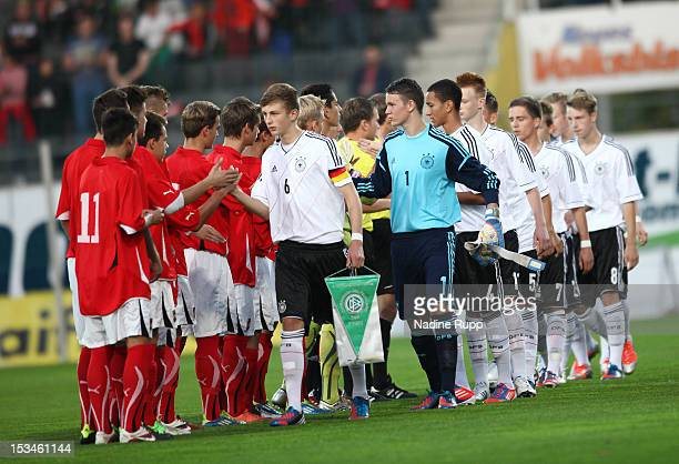 Captain Ole Kaeuper and the rest of the team shake hands with the Austrian players prior to the International Friendly U16 match between Austria U16...