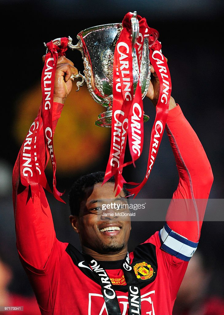 Captain <a gi-track='captionPersonalityLinkClicked' href=/galleries/search?phrase=Patrice+Evra&family=editorial&specificpeople=714865 ng-click='$event.stopPropagation()'>Patrice Evra</a> of Manchester United celebrates with the trophy after victory in the Carling Cup Final between Aston Villa and Manchester United at Wembley Stadium on February 28, 2010 in London, England.