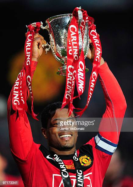 Captain Patrice Evra of Manchester United celebrates with the trophy after victory in the Carling Cup Final between Aston Villa and Manchester United...