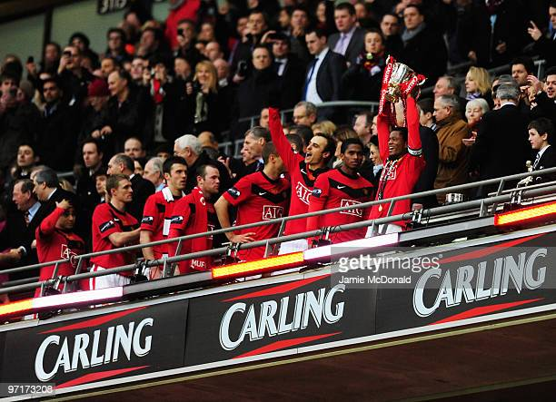 Captain Patrice Evra of Manchester United lifts the trophy after victory during the Carling Cup Final between Aston Villa and Manchester United at...