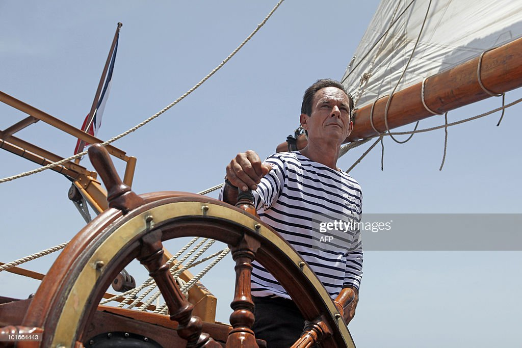 Captain Patrice Franceschi stands aboard the French schooner La Boudeuse sailing off the coast of city of Fort-de-France in the French Caribbean island of Martinique, on June 6, 2010. The three masted ship left the harbour of Fecamp in Brittany last November for a two-year scientific expedition entitled 'Terre-Ocean' (Earth Ocean) from South America to the Pacific Ocean. Patrice Franceschi announced on June 4, 2010 that the expedition around the world of La Boudeuse will end shortly due to lack of funds and that the ship will be sold soon in Martinique.