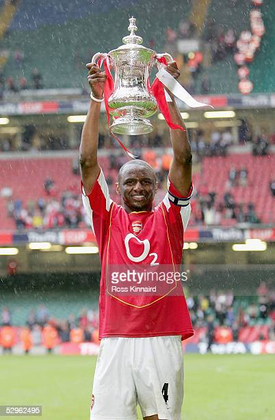 Captain Patrick Vieira of Arsenal holds aloft the trophy after winning the FA Cup Final between Arsenal and Manchester United 54 on penalty's at The...