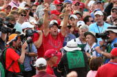 Captain Paul Azinger of the USA team celebrates in front of the media in honor of the USA 16 1/2 11 1/2 victory on the final day of the 2008 Ryder...