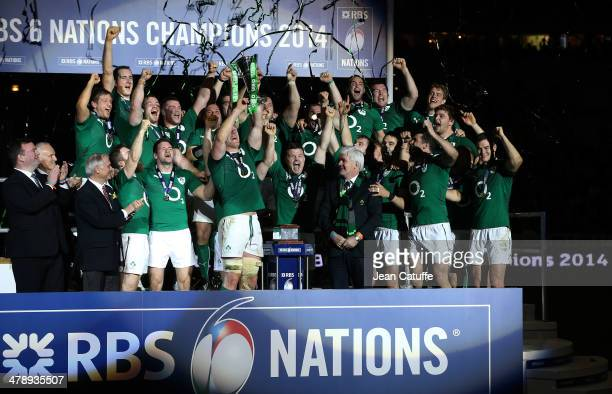 Captain Paul O'Connell Brian O'Driscoll of Ireland and teammates celebrate with the Six Nations Championship trophy after the RBS Six Nations match...