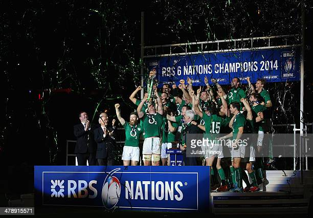Captain Paul O'Connell of Ireland and team mates celebrate with the Six Nations Championship trophy during the RBS Six Nations match between France...