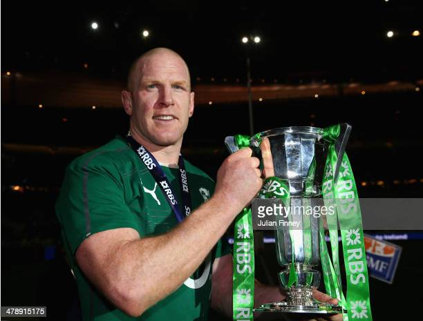 Captain Paul O'Connell of Ireland celebrates with the Six Nations Championship during the RBS Six Nations match between France and Ireland at Stade...