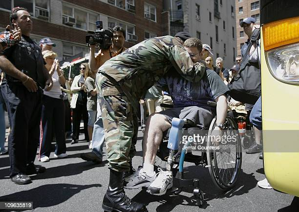 Captain Peter Lebow Director of the Soldiers Sailors and Airmans Club welcomes a wounded veteren to the Welcome Home celebration for Wounded Veterens...
