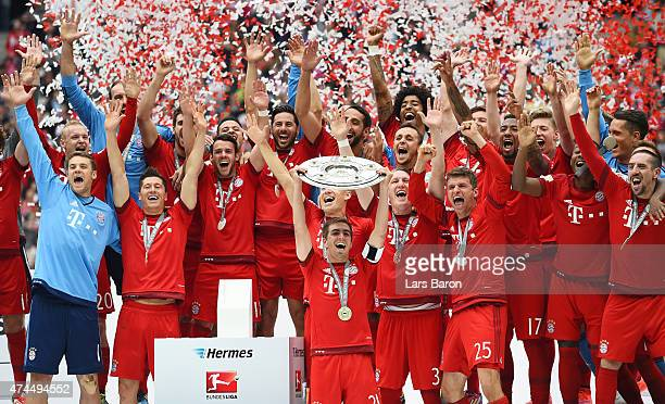 Captain Philipp Lahm of Bayern Muenchen lifts the Bundesliga trophy following the Bundesliga match between FC Bayern Muenchen and 1 FSV Mainz 05 at...