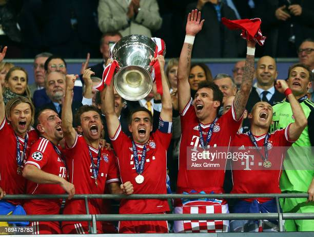 Captain Philipp Lahm of Bayern Muenchen lifts the trophy after winning the UEFA Champions League final match against Borussia Dortmund at Wembley...
