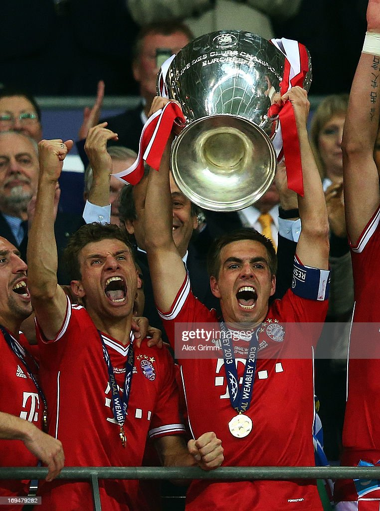 Captain <a gi-track='captionPersonalityLinkClicked' href=/galleries/search?phrase=Philipp+Lahm&family=editorial&specificpeople=483746 ng-click='$event.stopPropagation()'>Philipp Lahm</a> of Bayern Muenchen lifts the trophy after winning the UEFA Champions League final match against Borussia Dortmund at Wembley Stadium on May 25, 2013 in London, United Kingdom.