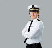 Young captain posing at camera.
