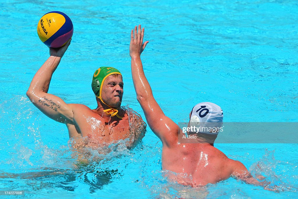 Captain Pierre le Roux looks to pass the ball under pressure from Luka Gasic of Canada during the Men's Water Polo first preliminary round match between Canada and South Africa during day three of the 15th FINA World Championships at Piscines Bernat Picornell on July 22, 2013 in Barcelona, Spain.