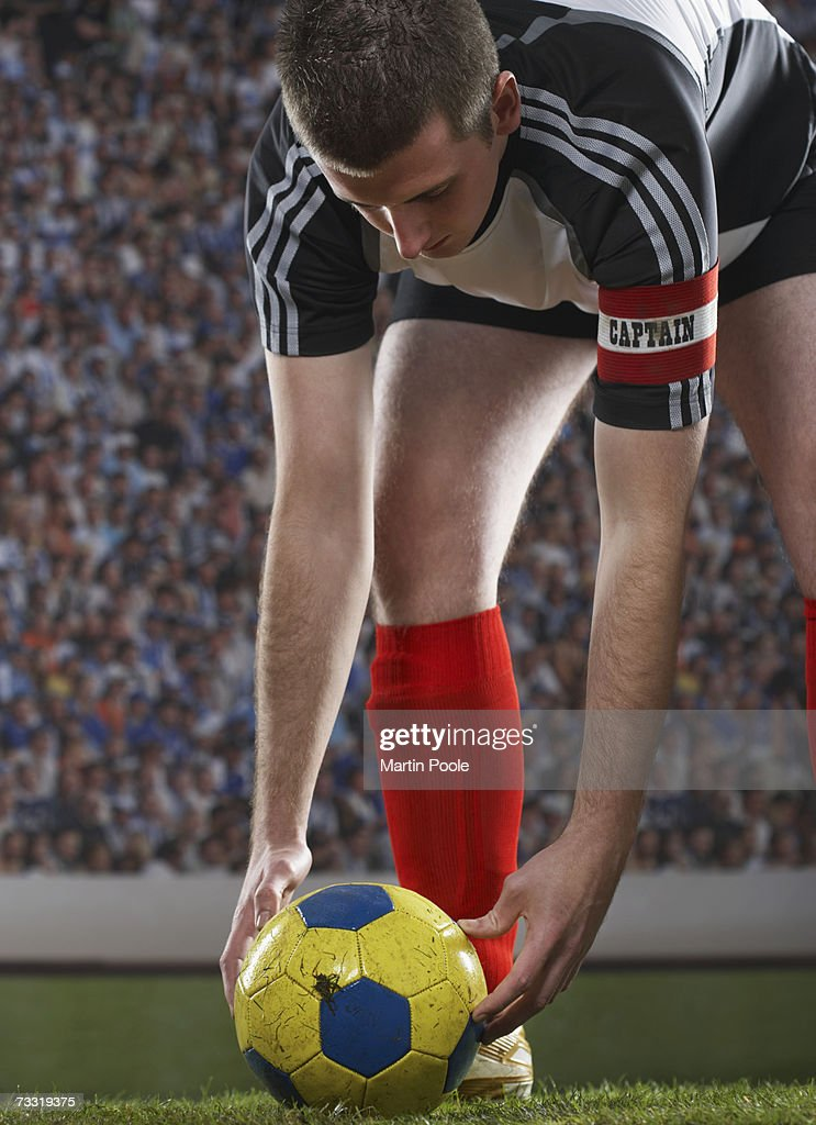 Captain positioning  soccer ball on field