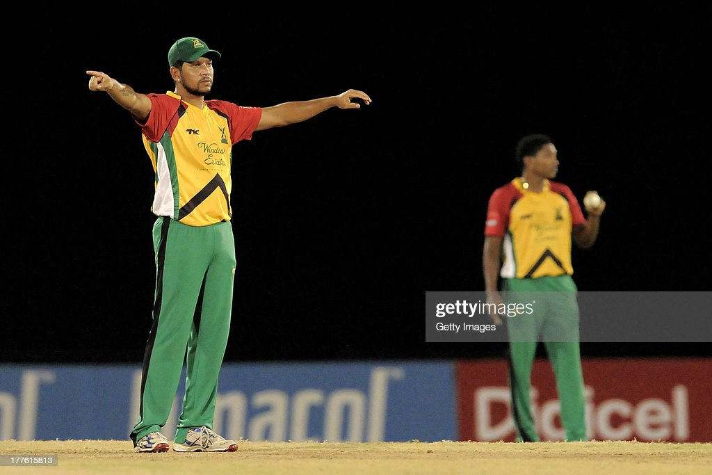 Captain <a gi-track='captionPersonalityLinkClicked' href=/galleries/search?phrase=Ramnaresh+Sarwan&family=editorial&specificpeople=176561 ng-click='$event.stopPropagation()'>Ramnaresh Sarwan</a> of Guyana Amazon Warriors sets the field for Krishmar Santokie (R) during the Final of the Caribbean Premier League between Guyana Amazon Warriors v Jamaica Tallawahs at Queens Park Oval on August 24, 2013 in Port of Spain, Trinidad and Tobago.