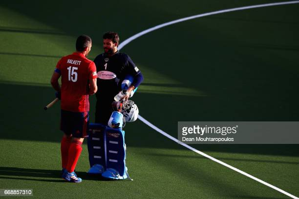 Captain Rhett Halkett of Mannheimer HC speaks to Goalkeeper Francisco Cortes of Club Egara after the Euro Hockey League KO16 match between Mannheimer...