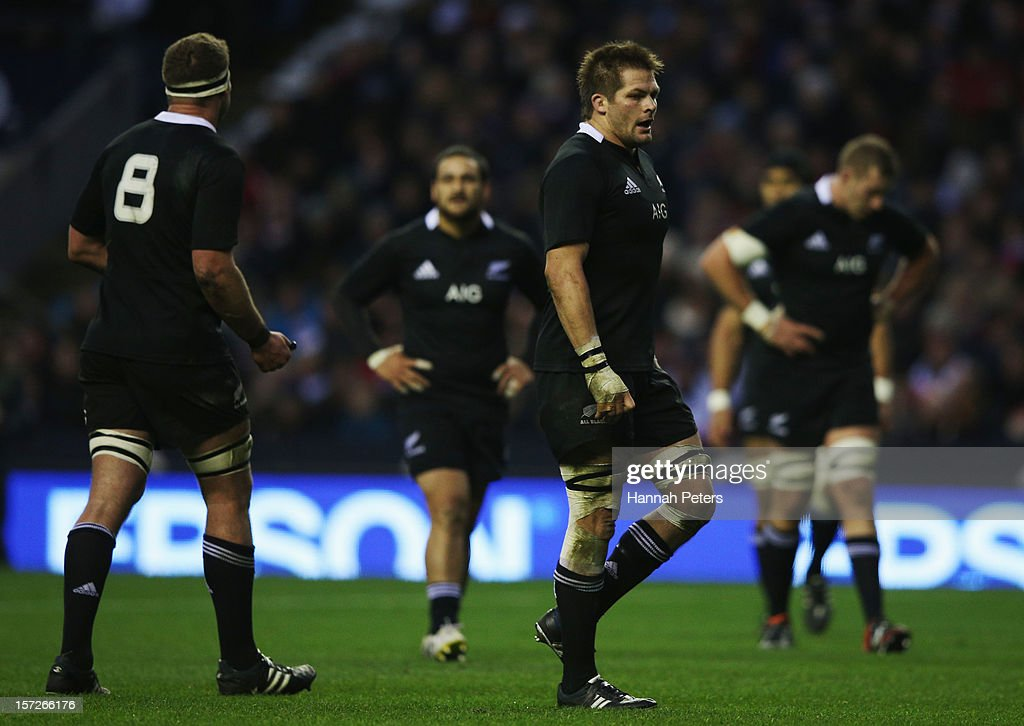 Captain <a gi-track='captionPersonalityLinkClicked' href=/galleries/search?phrase=Richie+McCaw&family=editorial&specificpeople=165235 ng-click='$event.stopPropagation()'>Richie McCaw</a> of New Zealand stands dejected during the QBE International match between England and New Zealand at Twickenham Stadium on December 1, 2012 in London, England.