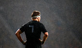 Captain Richie McCaw of the New Zealand All Blacks stands with his hands on his hips as the rain falls during the 2015 Rugby World Cup Semi Final...