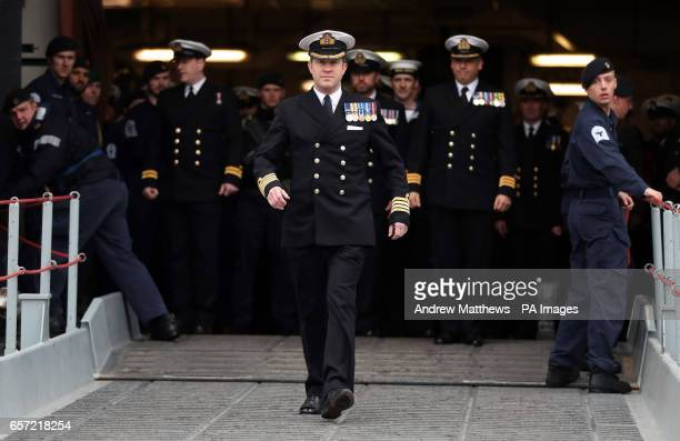 Captain Rob Pedre disembarks HMS Ocean the Royal Navy's fleet flagship as she returned to HM Naval Base Devonport Plymouth after six months on...