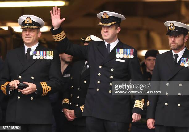 Captain Rob Pedre waves to family as he prepares to disembark HMS Ocean the Royal Navy's fleet flagship as she returned to HM Naval Base Devonport...