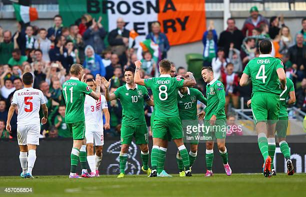 Captain Robbie Keane of Republic of Ireland celebrates with team mates after scoring a goal during the EURO 2016 Qualifier match between Republic of...