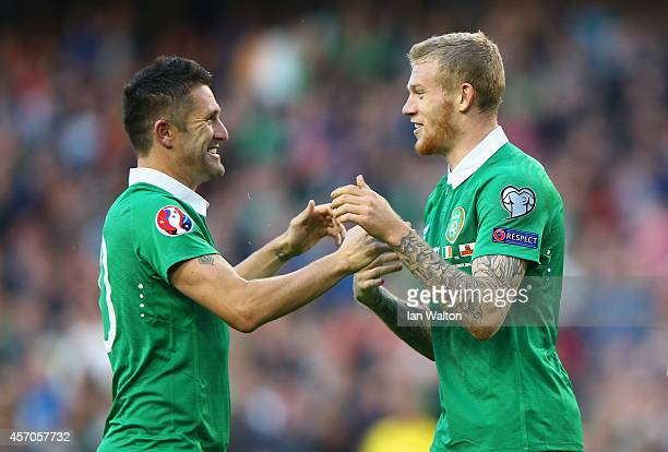 Captain Robbie Keane of Republic of Ireland congratulates James McClean of Republic of Ireland on scoring their fourth goal during the EURO 2016...