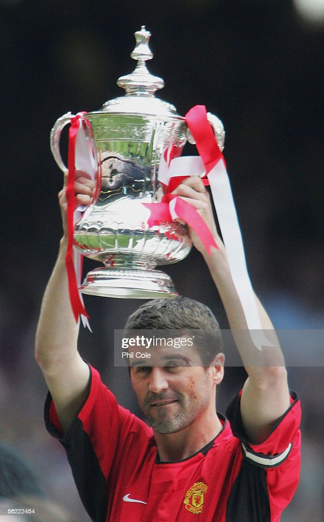 Captain Roy Keane of Manchester United lifts the FA Cup during the 123rd FA Cup Final between Manchester United and Millwall at The Millennium Stadium on May 22, 2004 in Cardiff, Wales.