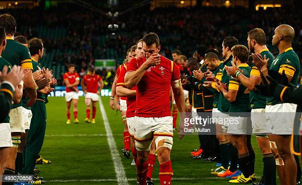 Captain Sam Warburton of Wales leads the Wales team off as the South Africa team applaud during the 2015 Rugby World Cup Quarter Final match between...