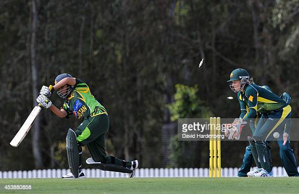 Captain Sana Mir of Pakistan is bowled out by Megan Schutt of Australia during the women's international series One Day match between the Australian...