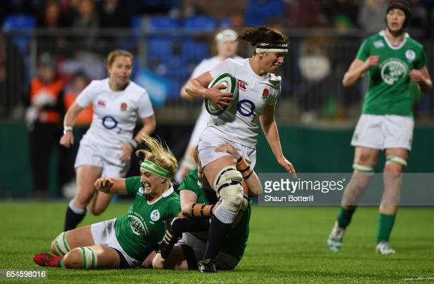 Captain Sarah Hunter of England is hauled down by the Ireland defence during the Women's Six Nations match between Ireland and England at Donnybrook...