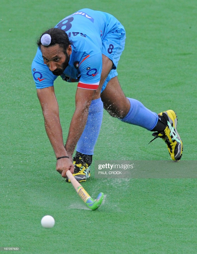 Captain Sardar Singh of India hits the ball during the pool B match between England and India at the Mens Hockey Champioships Trophy in Melbourne on December 1, 2012. India won the match 3-1. RESTRICTED TO EDITORIAL USE NO ADVERTISING USE NO PROMOTIONAL USE NO MERCHANDISING USE. AFP PHOTO/Paul CROCK