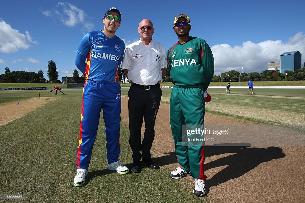 Captain Sarel Burger of Namibia, match referee Jeff Crowe and captain Rakep Patel of Kenya pose during the coin toss prior to the ICC World Cup qualifying match between Namibia and Keny on January 17, 2014 in Mount Maunganui, New Zealand.