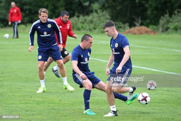 Captain Scott Brown of Scotland tackles teammate Kieran Tierney during the Scotland training session at Mar Hall on June 9 2017 in Glasgow Scotland