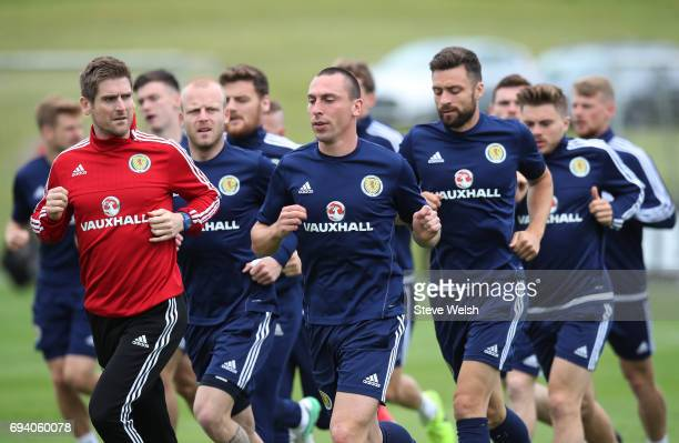 Captain Scott Brown of Scotland warms up during the Scotland training session at Mar Hall on June 9 2017 in Glasgow Scotland