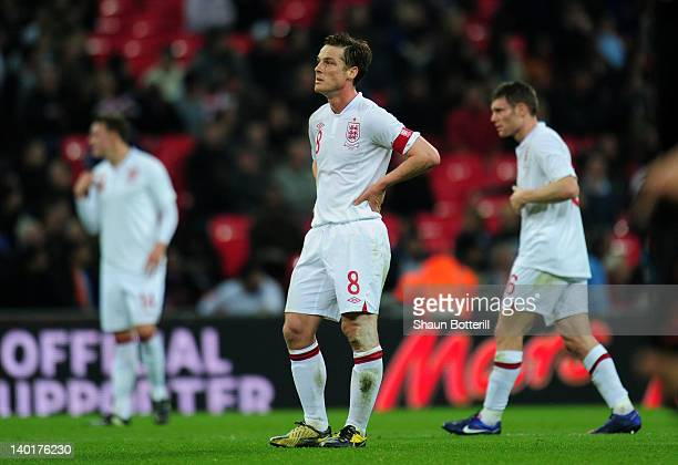 Captain Scott Parker of England shows his dejection next to teammate James Milner after Arjen Robben of Netherlands scored their third goal in the...