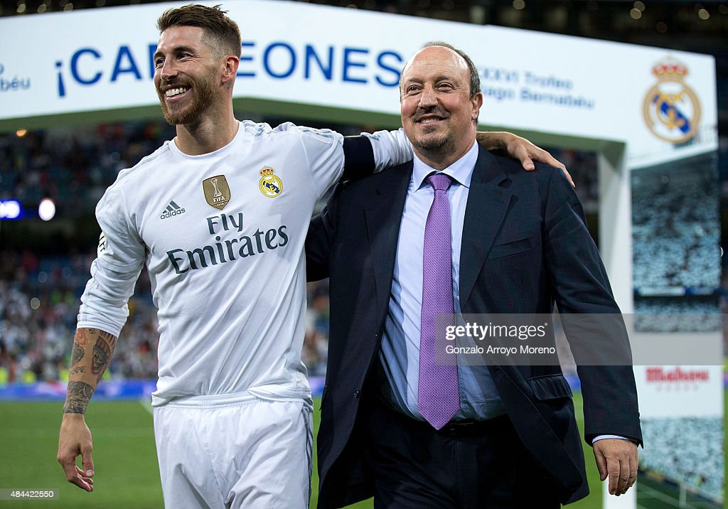 Captain Sergio Ramos (L) of Real Madrid CF embraces his head coach Rafael Benitez (L) after winning the Santiago Bernabeu Trophy match between Real Madrid CF and Galatasaray at Estadio Santiago Bernabeu on August 18, 2015 in Madrid, Spain.