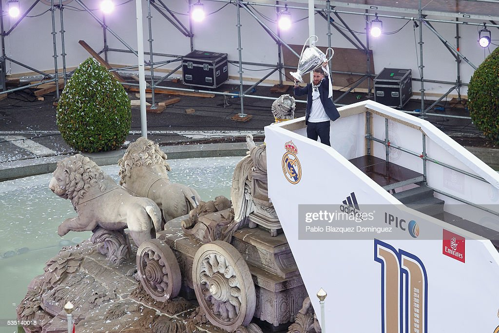 Captain Sergio Ramos of Real Madrid holds the trophy as he celebrates with his team and fans at Cibeles square after winning the Uefa Champions League Final match against Club Atletico de Madrid on May 29, 2016 in Madrid, Spain.