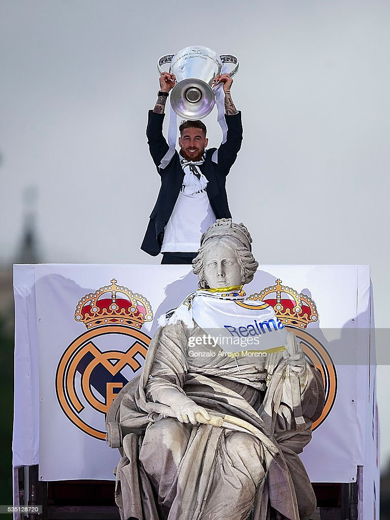 Captain Sergio Ramos of Real Madrid holds the Trophy in celebration behind Cibeles font after winning the Uefa Champions League Final match against Club Atletico de Madrid on May 29, 2016 in Madrid, Spain.
