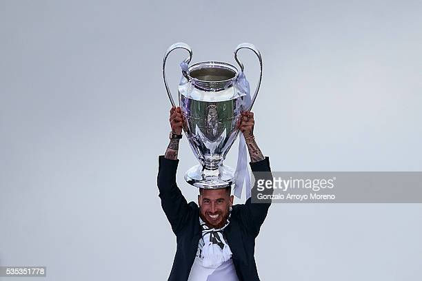 Captain Sergio Ramos of Real Madrid holds the Trophy in celebration at Cibeles Square during his team's celebration after winning the Uefa Champions...