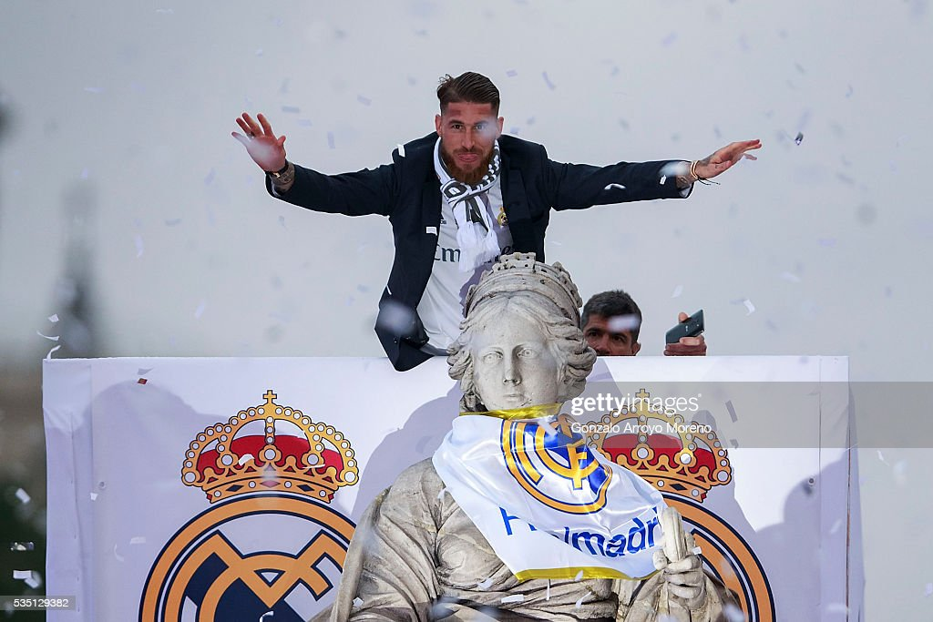 Captain Sergio Ramos of Real Madrid waves the crowd behind Cibeles statue during their team celebration at Cibeles square after winning the Uefa Champions League Final match against Club Atletico de Madrid on May 29, 2016 in Madrid, Spain.