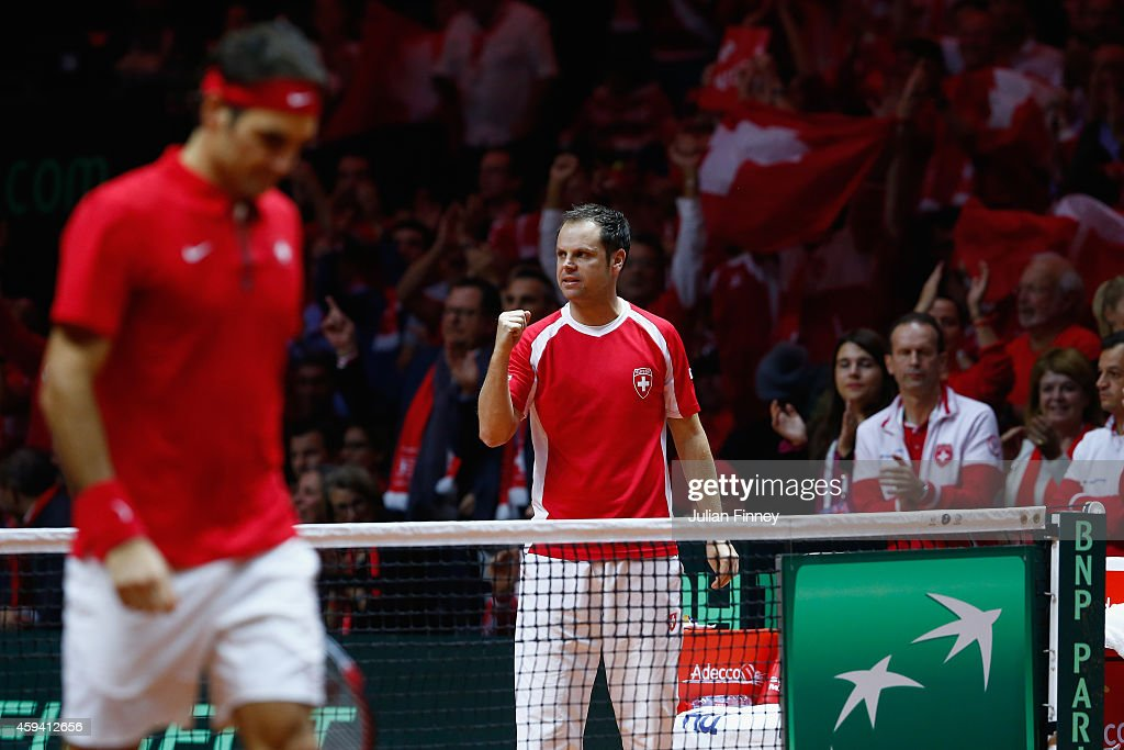 Captain Severin Luthi of Switzerland supports Roger Federer of Switzerland and Stanislas Wawrinka of Switzerland against Richard Gasquet of France and Julien Benneteau of France in the doubles during day two of the Davis Cup Tennis Final between France and Switzerland at the Stade Pierre Mauroy on November 22, 2014 in Lille, France.