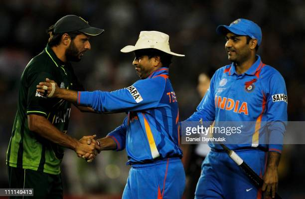 Captain Shahid Afridi of Pakistan congratulates Sachin Tendulkar of India after India defeated Pakistan during the 2011 ICC World Cup second...