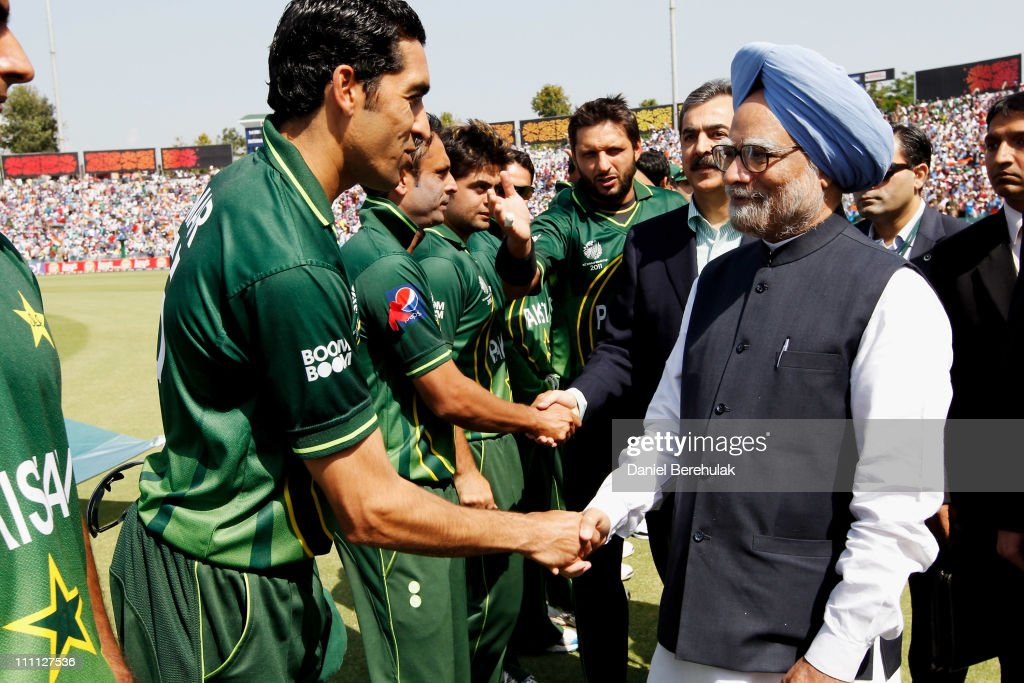 Captain Shahid Afridi of Pakistan introduces Umar Gul and his players to Prime Minister Manmohan Singh of India and Prime Minister Syed Yusuf Raza Gilani of Pakistan prior to the start of the 2011 ICC World Cup second Semi-Final between India and Pakistan at Punjab Cricket Association (PCA) Stadium on March 30, 2011 in Mohali, India.