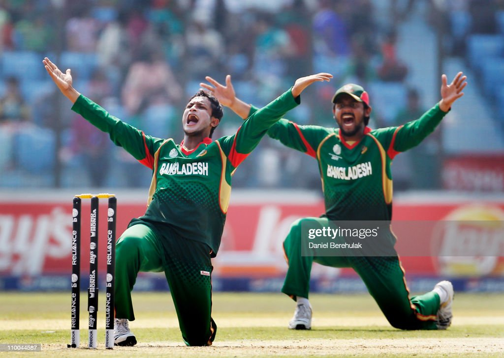 Captain <a gi-track='captionPersonalityLinkClicked' href=/galleries/search?phrase=Shakib+Al+Hasan&family=editorial&specificpeople=4145971 ng-click='$event.stopPropagation()'>Shakib Al Hasan</a> of Bangladesh and team mate Shahriar Nafees appeal successfully for the wicket of Wesley Barresi of the Netherlands during the 2011 ICC Cricket World Cup group B match between Bangladesh and the Netherlands at Zohur Ahmed Chowdhury Stadium on March 14, 2011 in Chittagong, Bangladesh.
