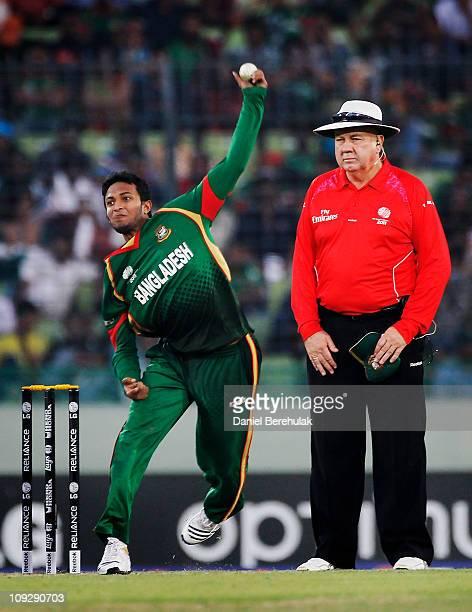 Captain Shakib Al Hasan of Bangladesh bowls during the opening game of the ICC Cricket World Cup between Bangladesh and India at the ShereeBangla...