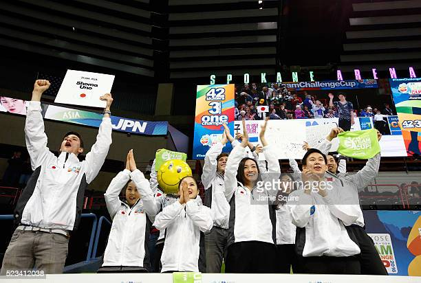 Captain Shizuka Arakawa and teammates cheer for Shoma Uno of Team Asia after the Men's Singles Short Program on day 1 of the KOSE Team Challenge at...